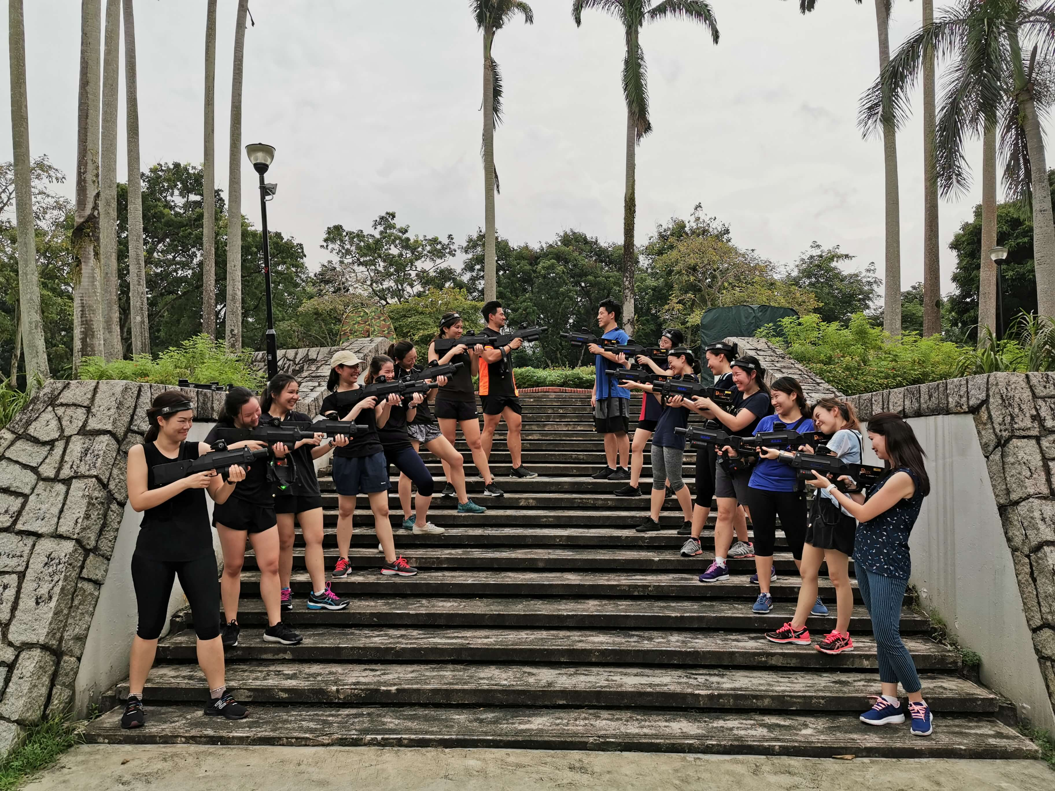a team of staff having laser tag for their team building